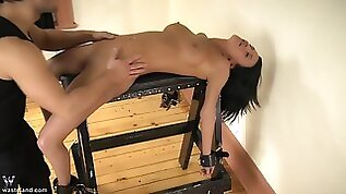 Teen tied to a table and gets wax and pussy torture