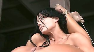 Flexible brunette slut shows off her skills in BDSM porn clip