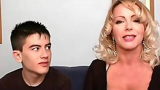 Big juggs milf in lingerie has her pussy stuffed with young man meat