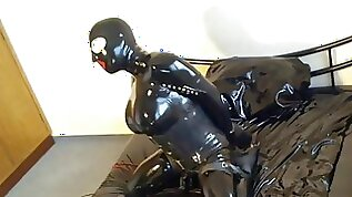 Tranny freak girl play with tits teases in rubber on webcam