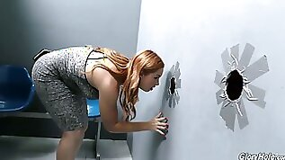 Ginger chick playing with red haired pussy Edyn Blair is having fun in the glory hole room