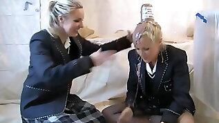 Two girls messing school uniforms