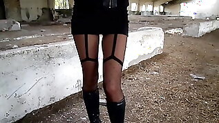 Walk through an abandoned farm heels tights and mini skirt