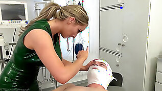 Female domination nurse checking patient