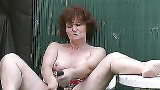 Matured granny bending over while inserted with toys