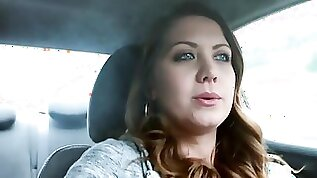 Chrissy Marie is smoking a cigar while driving a car