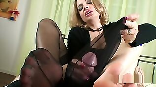 Handjob cum inside a black stocking