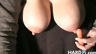 Insatiable doll with milk globes is draining herself in front of the camera and luving it