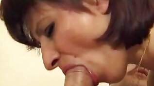 Girl gets horny and sucks hard cock on the bed
