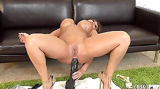 Big ass babe lubes her butthole and fucks it with huge toys