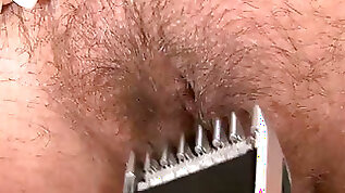 Busty milf shaves her pussy in hardcore video