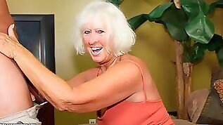 Cute blonde granny Jeannie knows how to suck a brown cock